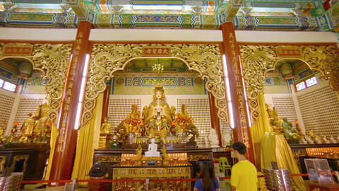 Worshippers praying to godess Mazu. inside ornate Thean Hou Temple Footage