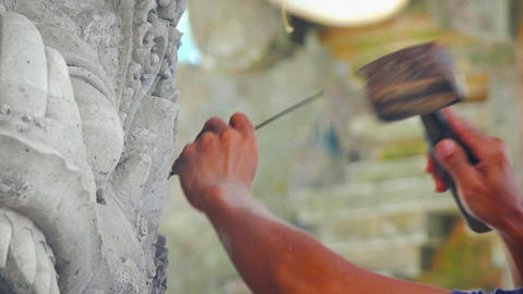Asian Sculptor Chiseling Fine Details with Traditional Tools Footage