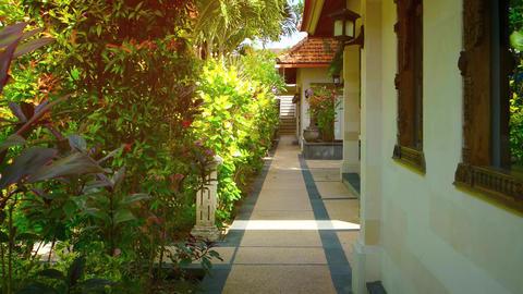 Walkway in the Garden Courtyard of a Luxury Resort Hotel Footage