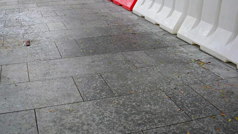 Urban Walkway Speckled by Water from a Brief Rain Footage