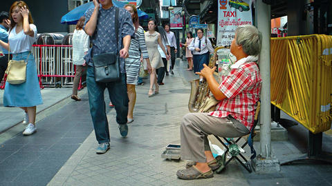 Talented street musician plays jazz with his saxophone Footage