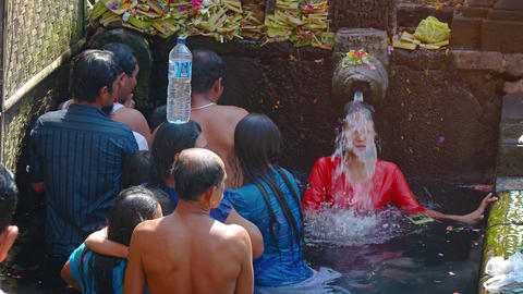 Locals bathing in the Holy Springs of Tirta Empul. a Hindu water temple Footage