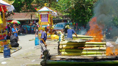 Human remains burn in handmade furnaces at a Hindu cremation ceremony Footage