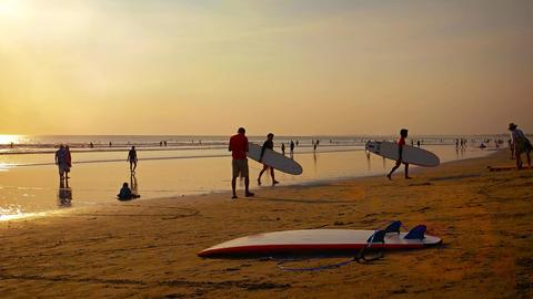Tourists enjoying the warm. tropical climate on a beautiful. sandy beach Footage
