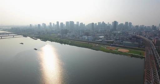 Traffic pass over large bridge into Osaka City aerial view city Skyline Footage