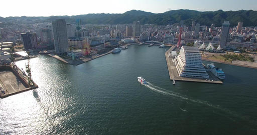 Aerial view cruise ship docking into kobe Harbour travel destination Japan Footage
