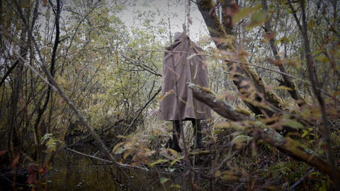 Hanged man in the gloomy wood dynamic Footage