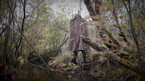 Hanged man in the gloomy wood dynamic Footage