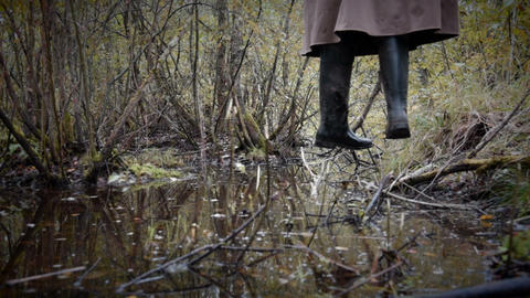 Feet of hanged man over the rotten swamp Footage