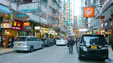 Western and Chinese businesses on a busy commercial... Stock Video Footage