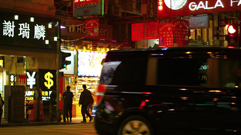 Busy night time shopping area in Hong Kong. China Footage