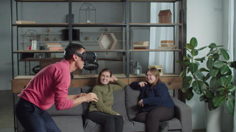 Excited man testing virtaul reality headset indoors Live Action