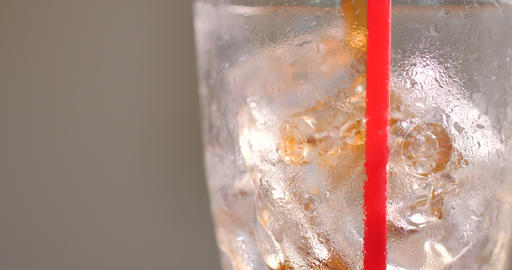 Close-up shot pouring brown cola water into the glass select focus shallow depth of field GIF