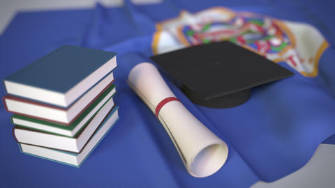 Graduation cap, books and diploma on the flag of Minnesota. Higher education in Live Action