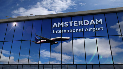 Airplane landing at Amsterdam mirrored in terminal Live Action