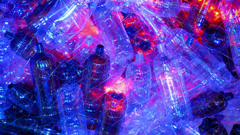 Ecology concept - plastic bottle installation with blue and red illumination Live Action
