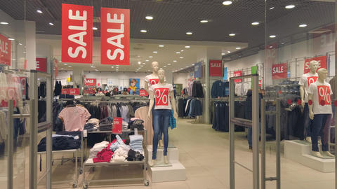 People in a clothing store in a large supermarket. Sale in a clothing store Live Action