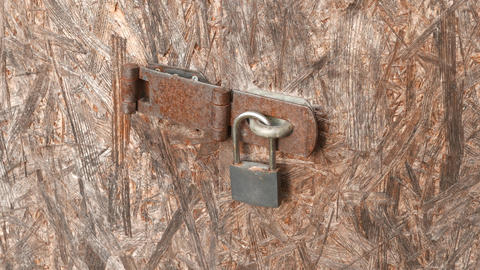 4K Padlock on Worn Plywood Door Live Action