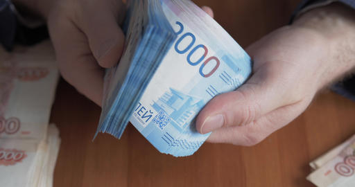 Male hands counting money. Russian money banknotes of 2,000 rubles Live Action