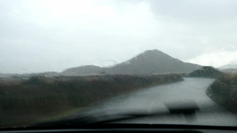 Driving under heavy rain on a lonely road Live Action