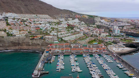 Aerial view of the houses of Puerto de Santiago, the city, marina of Los Live Action