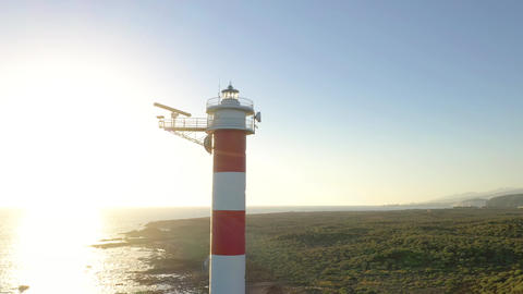 View from the height on the lighthouse and the ocean around at sunset Live Action