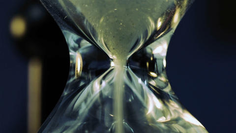 Sand Flowing Through An Hourglass Footage