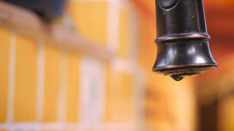 Close up of a leaky faucet dripping and wasting water Footage