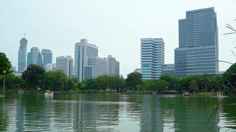 Urban Lake Park under Highrise Buildings of a Major City Footage