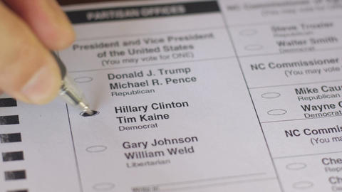 Close up a voter voting for the democrat Hillary Clinton and Tim Kaine with a bl Footage