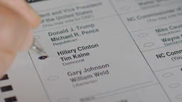 A voter's ballot is crumbled up while voting for Hillary Clinton during the 2016 Footage