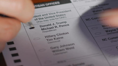 A voter's ballot is crumbled up while voting for Donald Trump during the 2016 ge Footage