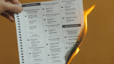A republican ballot with Donald Trump marked is burnt with a match by an angry v Live Action
