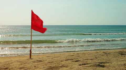 Red Safety Flag Flying on a Tropical Beach Paradise Footage