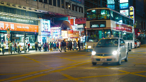 Busy pedestrian and vehicle traffic at major Hong Kong intersection. at night Footage