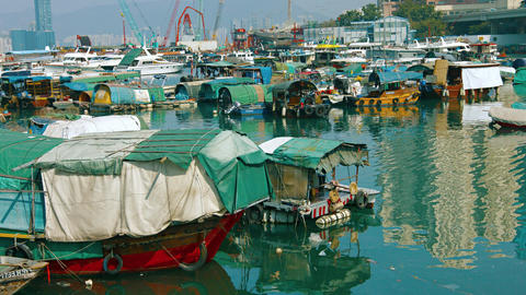 Community of boat people. moored together in a harbor at Hong Kong. China Footage
