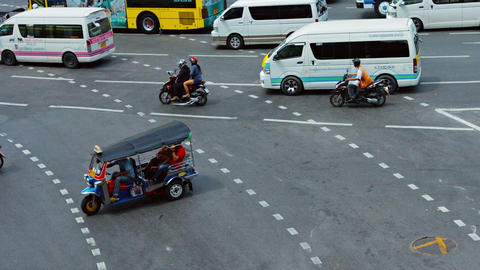 Motorbike. cars and busses urban traffic move on wide big cross road Footage