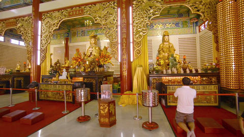 Worshippers praying inside Thean Hou Buddhist temple in Kuala Lumpur Footage