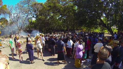 Tourists and mourners gather to pay respects at a Hindu cremation ceremony Footage