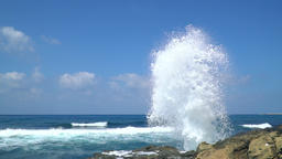 Great waves splashing high to the sky at the shore, slow motion Footage