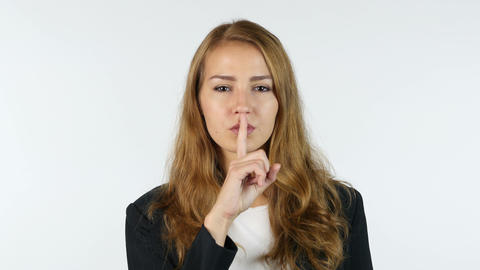 Silence , Businesswoman showing Silence Gesture, Portrait, White background Footage