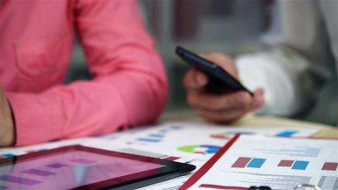 Employees Analyze Budget Footage