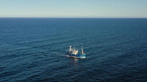 Aerial view of a fishing boat sailing in the Atlantic Ocean Live Action