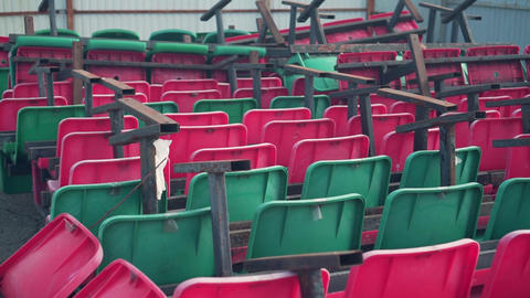 Landfill seats in different colors from the stadium. Stadium dumping chairs Live Action