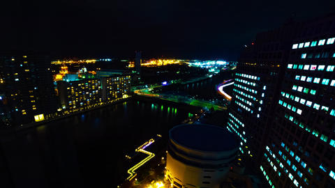 A night timelapse of cityscape at the urban town in Shinagawa Tokyo wide shot Live Action