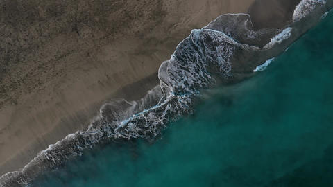 Top view of the desert black beach on the Atlantic Ocean. Coast of the island of Live Action