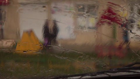 While the car was moving, a drop of water was falling on the glass of the car Live Action