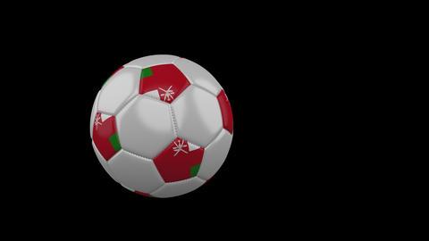 Oman flag on flying soccer ball on transparent background, alpha channel Animation