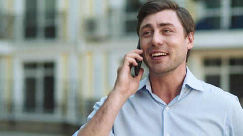 Closeup businessman celebrating victory. Man having phone talk at street Live Action