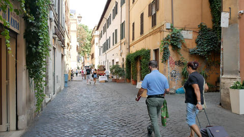 Old street in Trastevere rione in Rome in summer Live Action